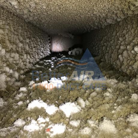 Severely Dirty Fiber Glass Air Duct - BEFORE Cleaning